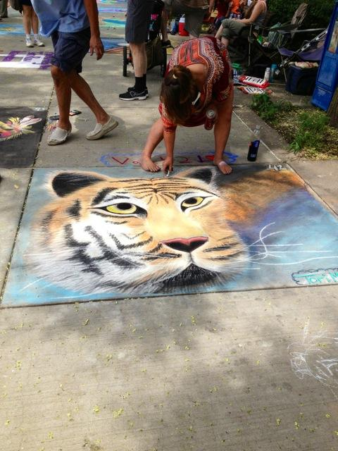 A chalk artist puts on the finishing touches right befor judging