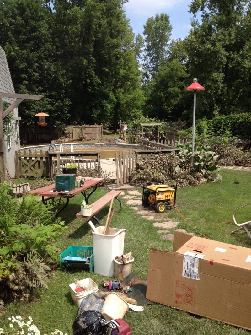 Steven Loucks of Oneida has household contents on his backyard as he cleans out from flooding