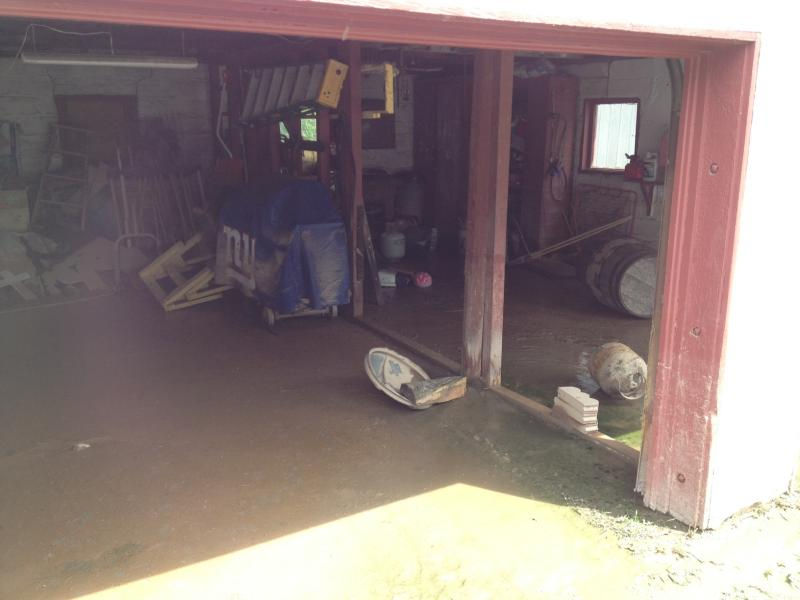 Steven Loucks of Oneida still has water receding out of his garage.