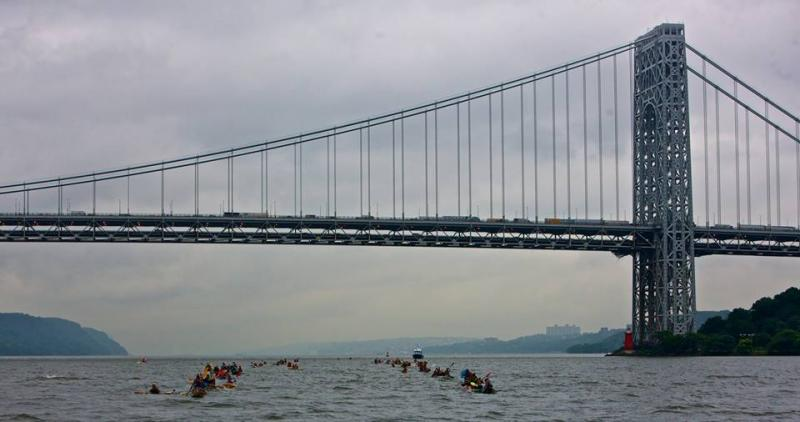 The paddlers travel beneath the George Washington Bridge