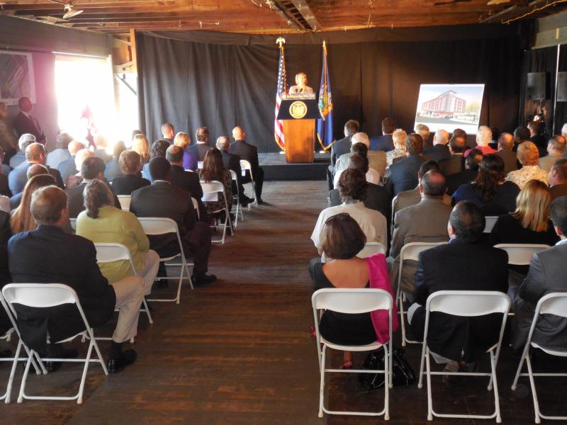 Onondaga County Executive Joanie Mahoney addresses the crowd inside the freight building on the Inner Harbor