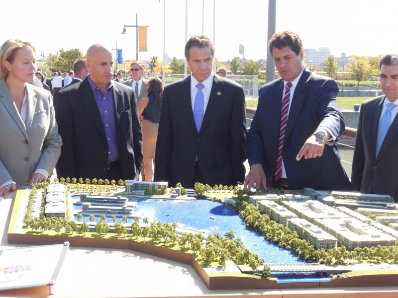 Left to right:  Onondaga County Executive Joanie Mahoney, Starwood Hotels Senior Director of Development John Salvatore, Governor Cuomo, and COR Development's Steve Aiello, and Assemblyman Bill Magnarelli look at a model of what the harbor might look like