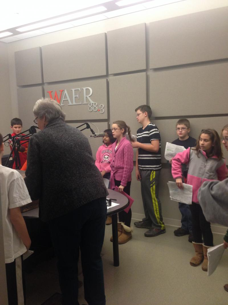 Students getting situated in WAER's talk studio