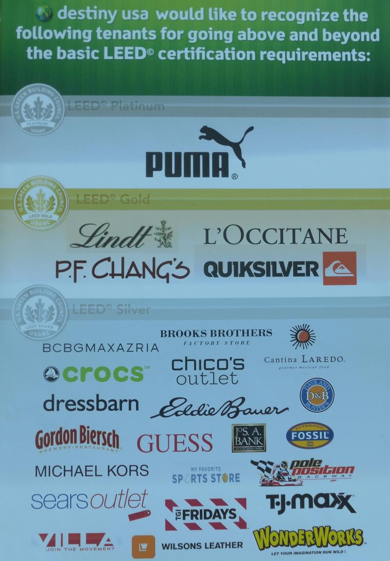 poster with series of brand logos, puma at the top with a platinum certification