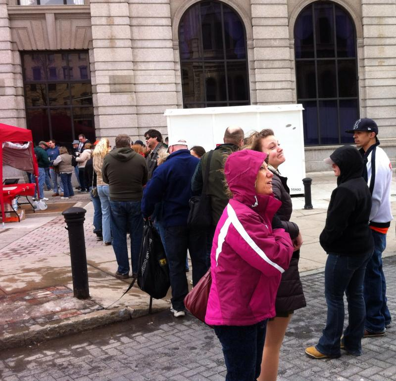 A line of folks wait to buy their tickets for the sandwich stroll and margarita mix-off