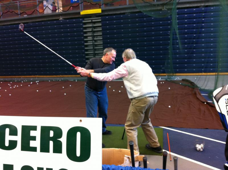 Chuck Jonick of Cicero Driving Range gives a free lesson