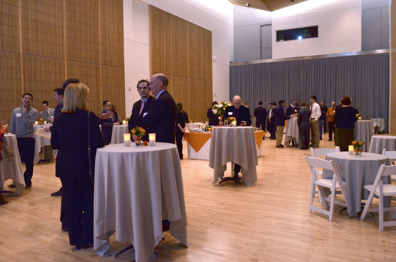 Attendees gather early to mix and mingle in Newhouse III