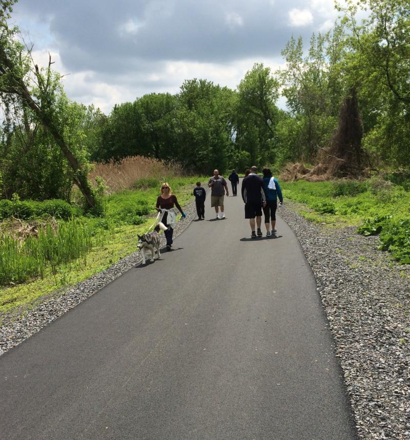 Walkers enjoy the new 2.5 mile extention of the West Shore trail around Onondaga Lake.