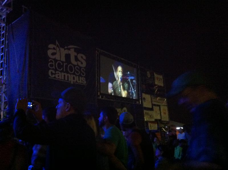 A large video screen helps festival goers get closer to the music