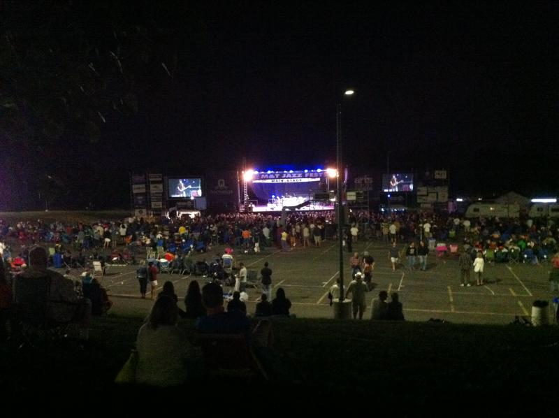 A view of the main stage from the hill as the music grooves into the night