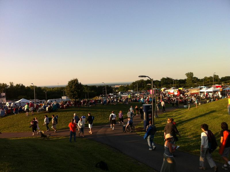 This hills of Jazz Fest at OCC with downtown Syracuse in the background