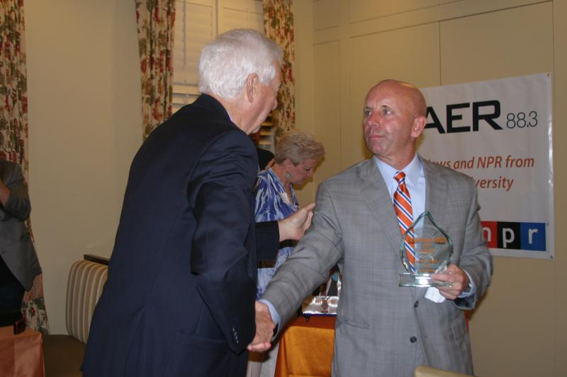 Bill Raftery presents award to Sean McDonough