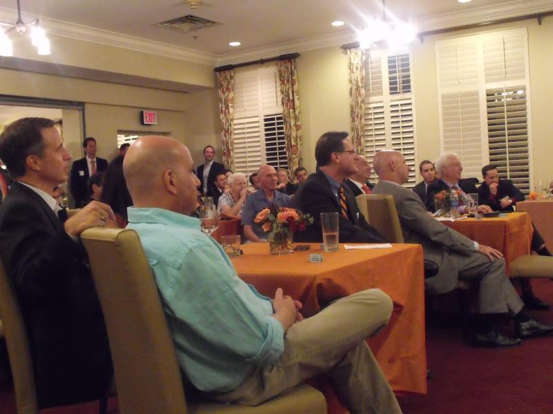 Attendees look on as Bill Roth and Sean McDonough are inducted into the WAER Hall of Fame