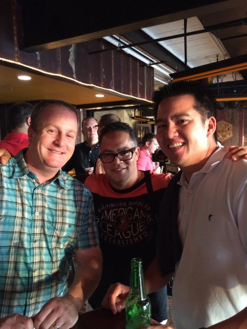 WAER alumni Jon Bloom (left) and Robert Lee (right) pose with WAER GM Joe Lee