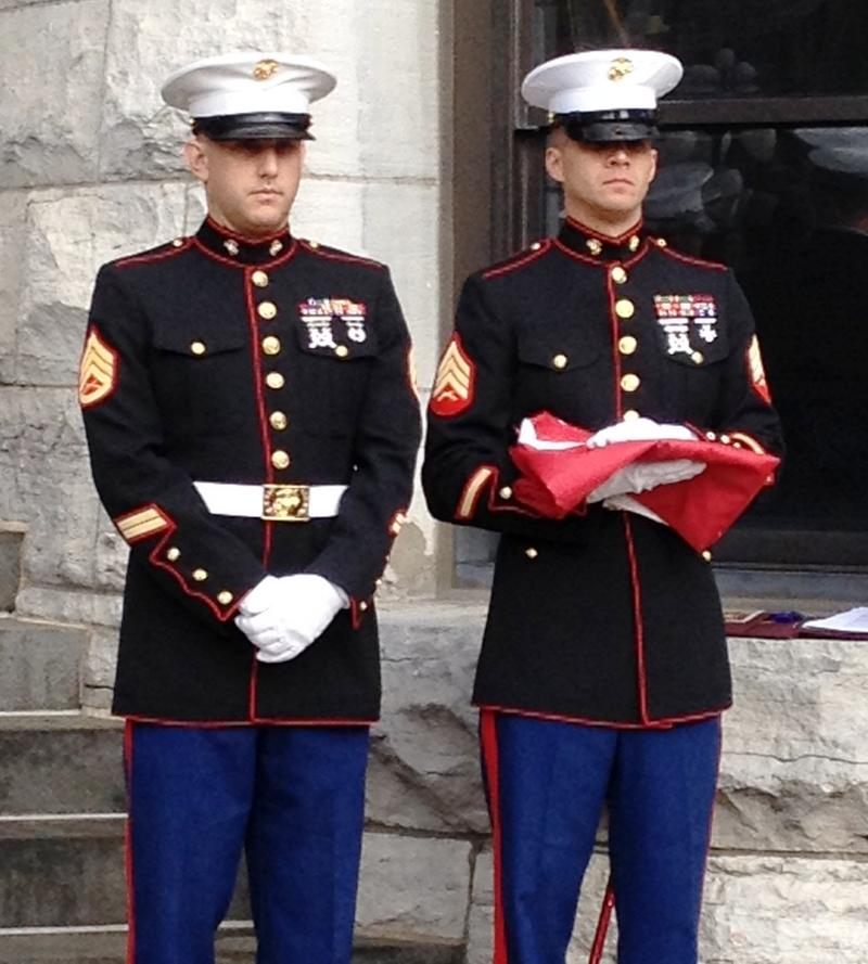 Local Marines stand at attention, ready to raise the flag at City Hall.