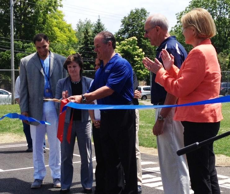 Officials cut the ribbon on the newly renovated Comfort Tyler Park.  Left to right, Syracuse Parks Commissioner Lazarus Sims, Mayor Stephane Miner,the Jim and Juli Boeheim Foundation's Mike Bristol, Coach Jim Boeheim, and County Executive Joanie Mahoney.