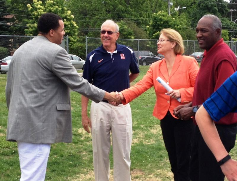 County Executive Joanie Mahoney greets Syracuse Parks Commissioner and former SU basketball player Lazarus Sims as Coach Jim Boeheim looks on.  Former player and former Syracuse Police Chief Dennis DuVal is at right.