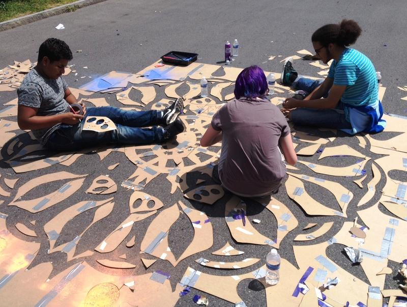 Young artists with the Talent Agency challenge themselves with some street art on Oswego St. between Blodgett Academy and Skiddy Park.  Hear the story at the bottom of the page.