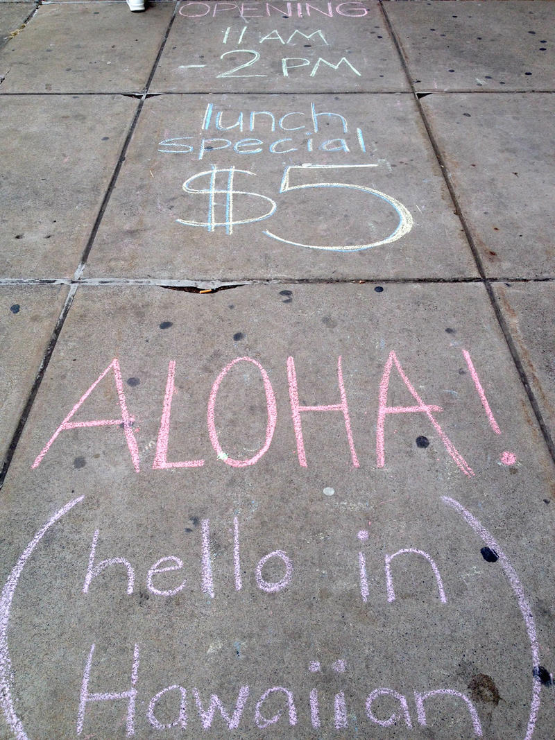 Aloha Japanese Bento Express used chalk to advertise their grand opening Thursday.