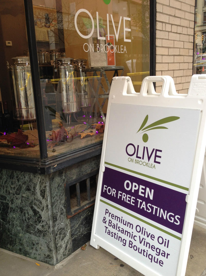 Michelle Watts opened the second Olives on Brooklea, a store which features specialty olive oil, vinegar, pastas, and sauces, downtown Thursday. Her original store is located in Fayetville.