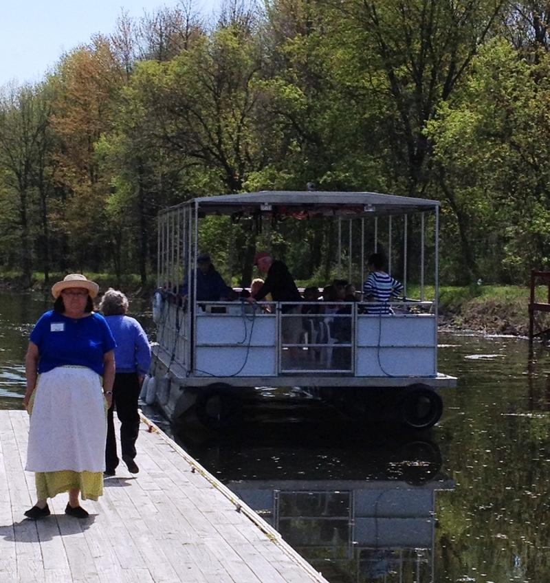 Children return from a boat tour of the Erie Canal.