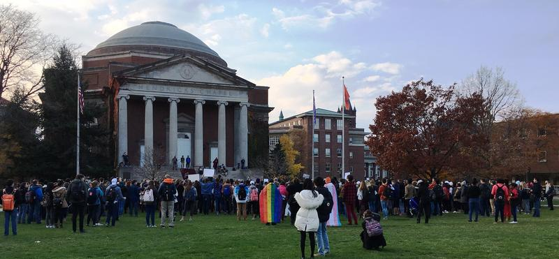 Students and faculty assemble on the SU quad.