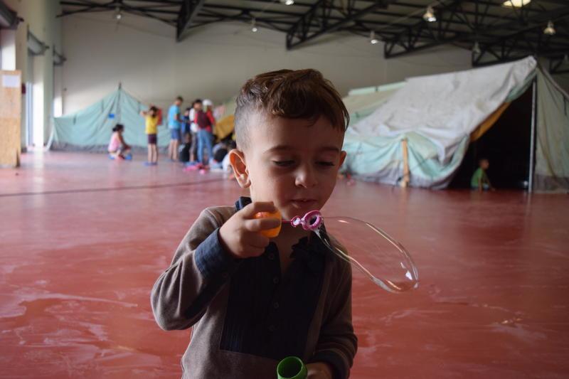 Children play in refugee camp in Thessaloniki Greece