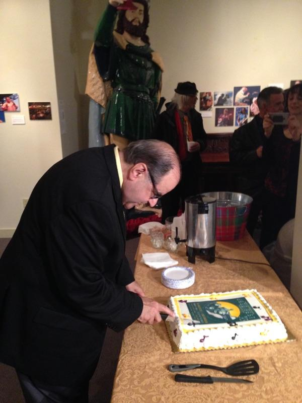 Jazzfest founder and Executive Director Frank Malfitano cuts the cake to open the exhibit and also celebrat this year's 35th edition of the festival