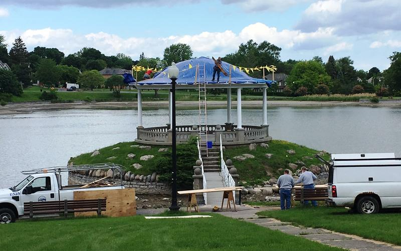 City crews replace the roof on the Gazebo.  Crews will also repair parts of the stone wall surrounding the lake.