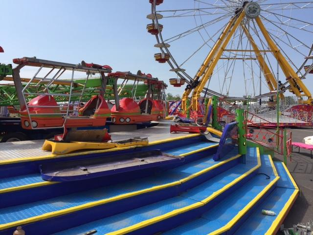 Rides at the State Fair Midway are in various stages of construction, all getting ready for openign day Wednesday