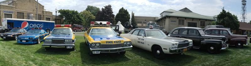 A panoramic shot of the various patrol cars used by the state police over the past several decades.