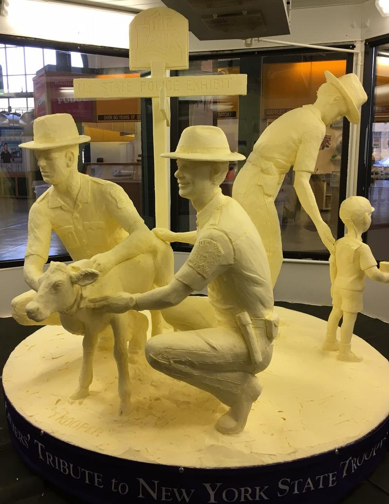 This year's butter sculpture honors the centennial of the state police.