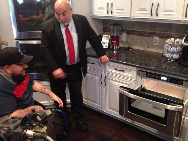 CEO of Tunnel2Towers gives Leyva a tour of the kitchen.