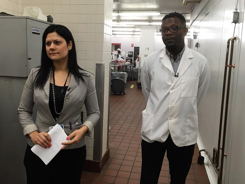 Rachel Murphy, left, is director of food and nutrition services for SCSD.  She and Chris Jones stand outside a large freezer.