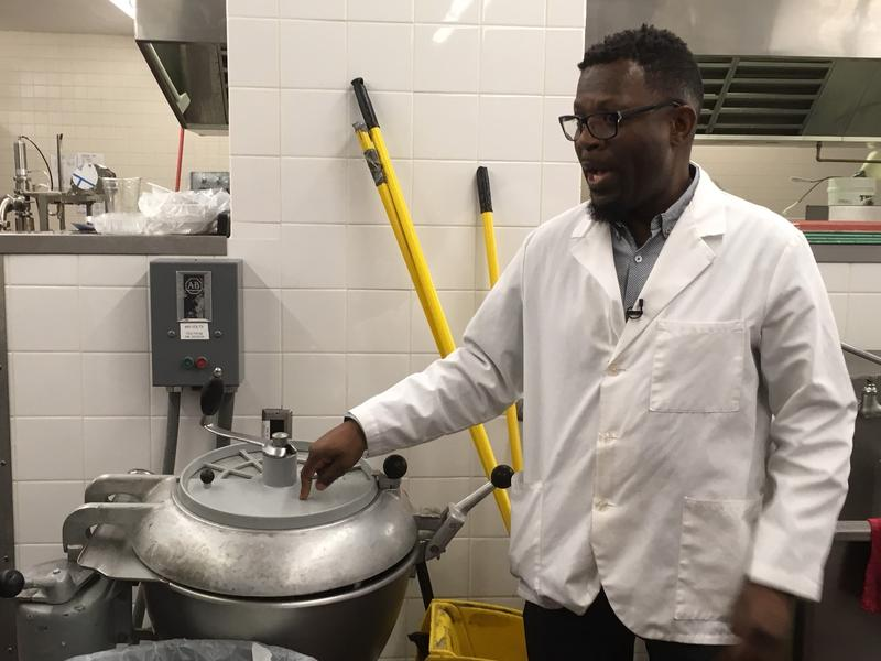 Fowler's school lunch manager Chris Jones stands by a giant food processor.  He says it's a priceless piece of equipment that's getting old and needs replacing.