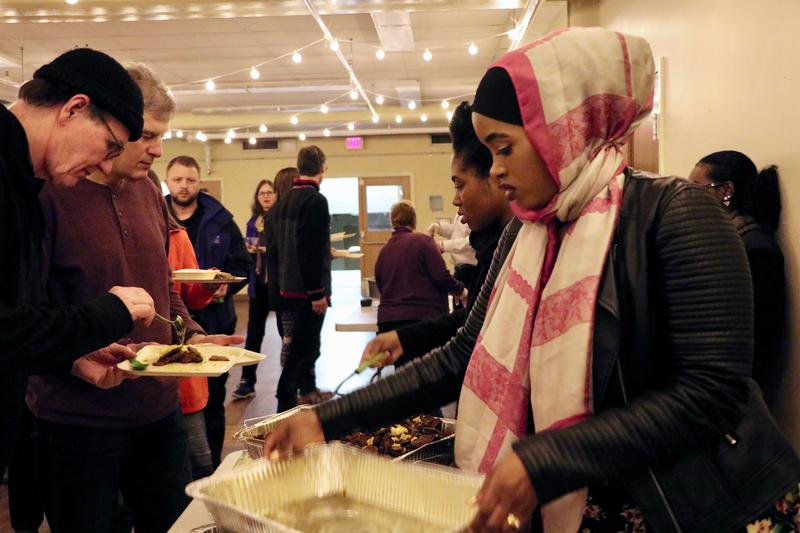 Habiba Boru serves chechepsa at My Lucky Tummy, an international food court pop-up held twice a year in Syracuse.