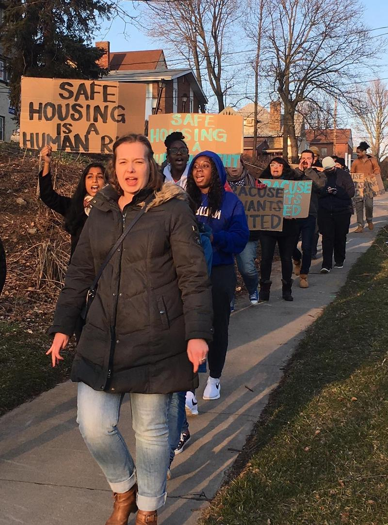The tenants and some supporters march to the SQL leasing office to drop off their demand letters.