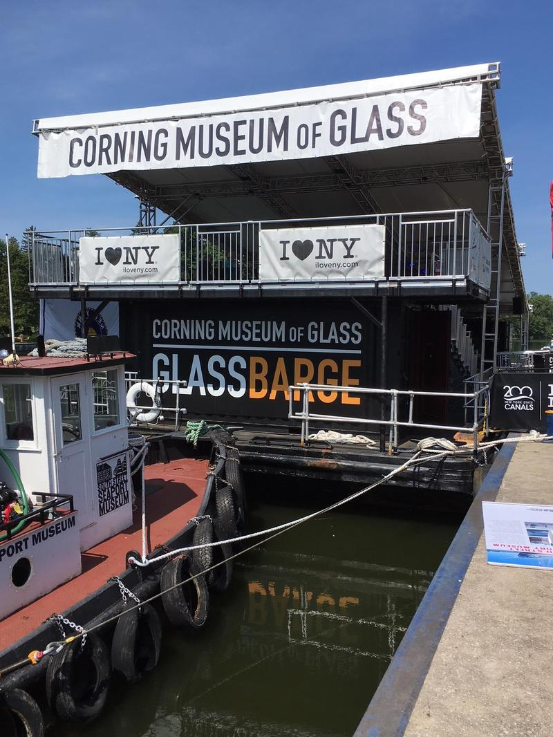 A historic tug moves the  GlassBarge along the canal.