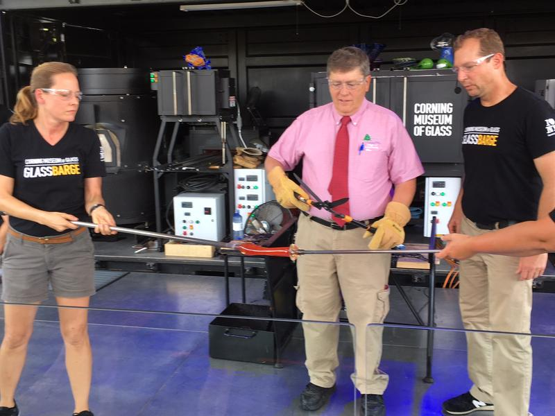Baldwinsville Mayor Dick Clark gets ready to cut the ribbon with a pair of hedge shears.