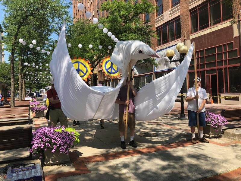 The white dove soaring through Downtown Syracuse on Monday represented the peace the protesters were calling for.