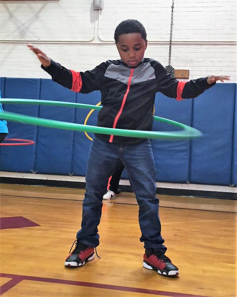 A Seymour student masters the hula hoop during an exercise demonstration.