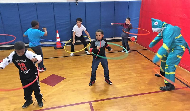 Most of the students could manage the hula hoop, but it proved to be a bit tricky for for Finn, a baby shark that represents kids born with congenital heart defects.