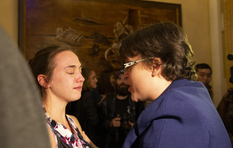 Dana Balter, the Democratic candidate for the 24th congressional district in New York, speaks to supporter Allison Kirsch after learning of her predicted loss.