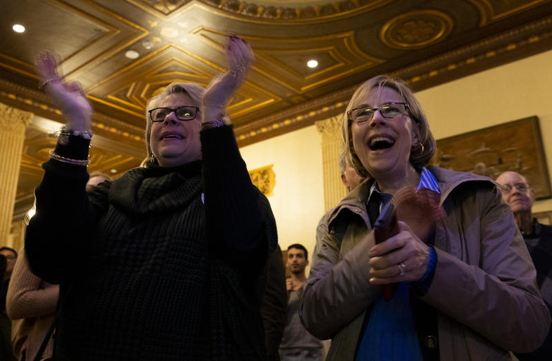 Debbie Cummings and Donna Coloton Forman celebrate predicted Democratic victories at the Onondoga County Democratic Committee's midterm election watch party.  Both campaigned for the N.Y. state senate campaign for John Mannion.