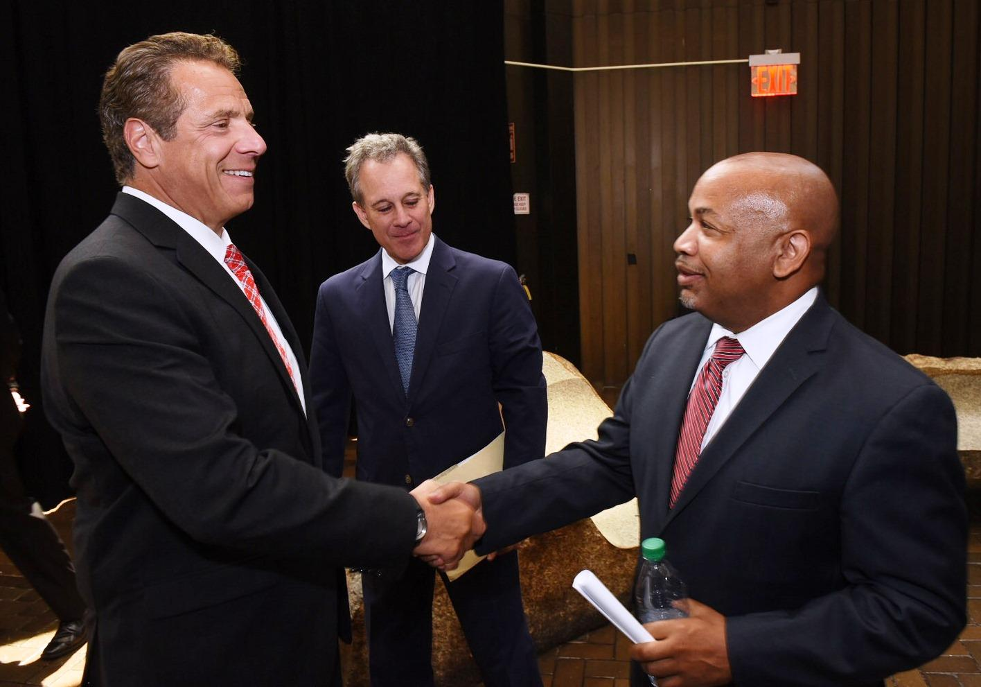 Gov. Cuomo AG Eric Schneiderman and Assembly Speaker Carl Heastie greet each other at a rally Monday