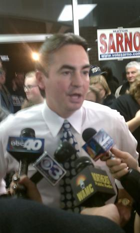 Springfield Mayor Domenic Sarno speaks to reporters after he was re-elected to a third term in 2011