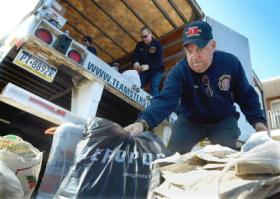 West York, PA Fire Department Capt. Stu Frey collects donations for victims of Hurricane Sandy