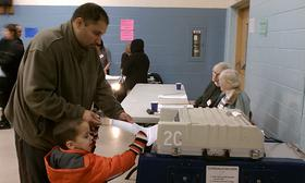 A voter casts a ballot in Springfield MA in this file photo from 2012