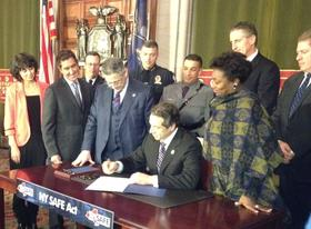 NY Governor Andrew Cuomo puts his pen to the gun bill.