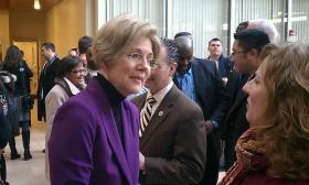 US Senator Elizabeth Warren (D-MA) speaks with Rebecca Townsend of Longmeadow at the opening of the senator's new western Massachusetts office in downtown Springfield